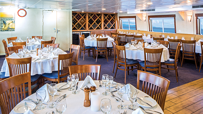 Ship Dining Room Remodel of Lindblad Sea Bird by Shellback Interiors